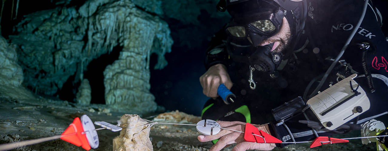 cave diver placing navigation markers